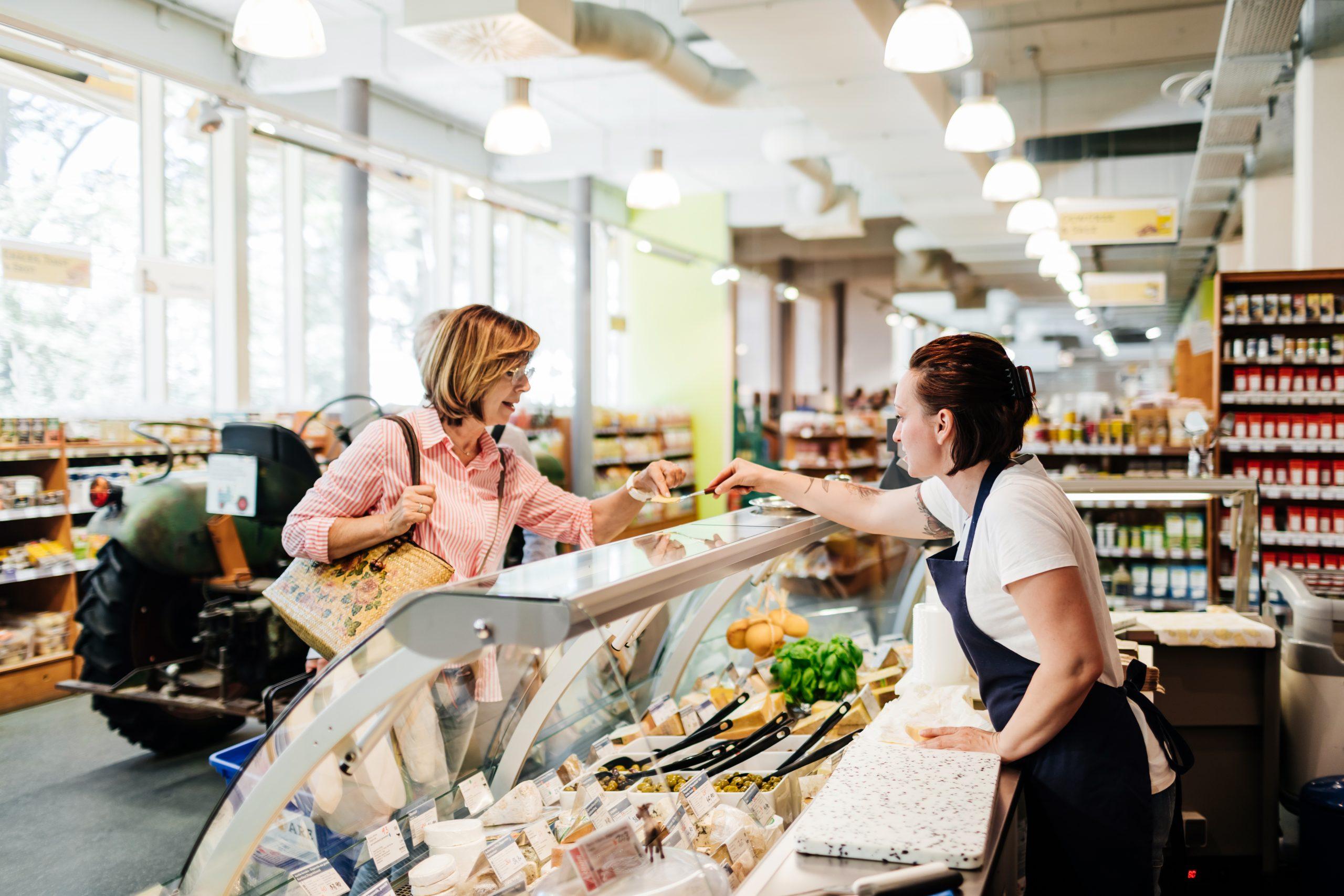 Lady buying fresh food in supermarket